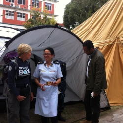 nurse outside ShelterBox tent field hospital